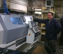 Ian Salter, Director of Precision Components Manufacturing Limited with his new Harrison Alpha 1400XS manual/cnc lathe